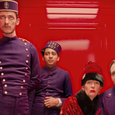 """This film image released by Fox Searchlight Films shows Paul Schlase, Tony Revelori, Tilda Swinton and Ralph Fiennes in a scene from """"The Grand Budapest Hotel."""" (AP Photo/Fox Searchlight Films, Martin Scali)"""